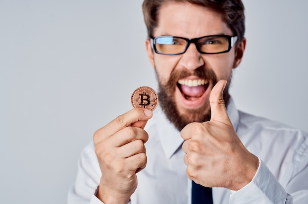 Cheerful man gold coin bitcoin cryptocurrency finance