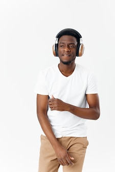 Cheerful man in headphones listening to music entertainment technology isolated background