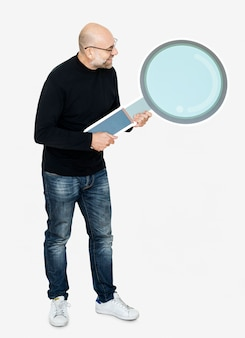 Cheerful man holding a magnifier icon