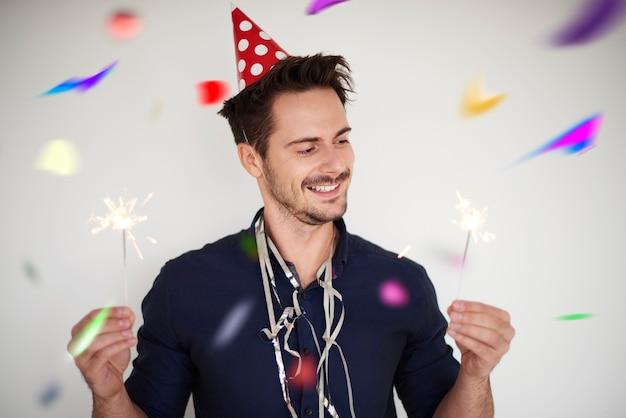Cheerful man and light sparklers