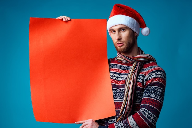 Cheerful man in new year's clothes advertising copy space isolated background. high quality photo