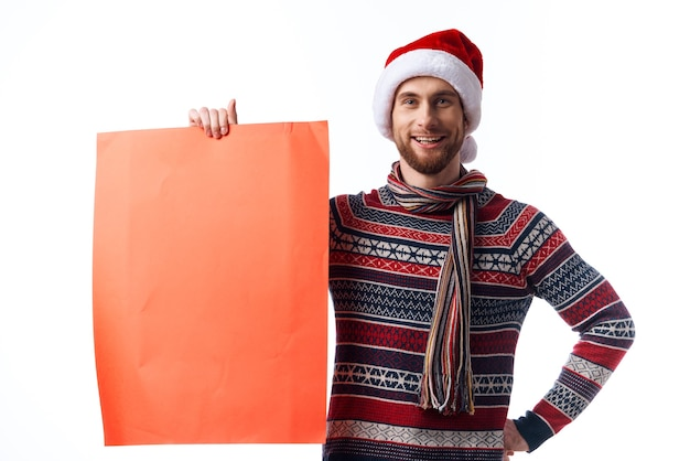 Cheerful man red paper billboard advertising christmas light background