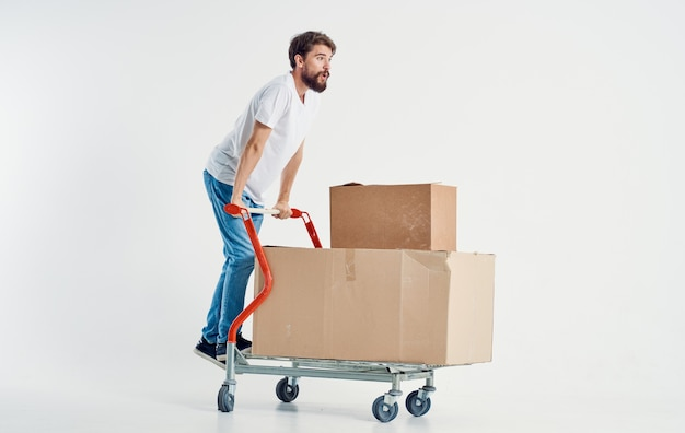 Cheerful man shipping transport in a box isolated background