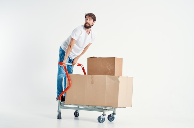 Cheerful man shipping transport in a box light background