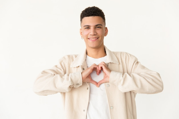 Cheerful man showing hand heart symbol