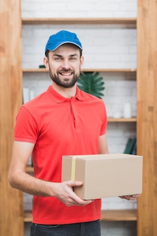 Cheerful man with parcel