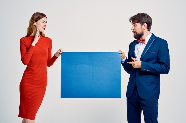 Cheerful man and woman mockup poster copy space studio