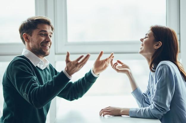 Cheerful man and woman talking