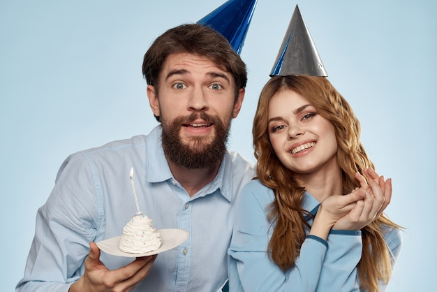 Cheerful man and woman with cake i