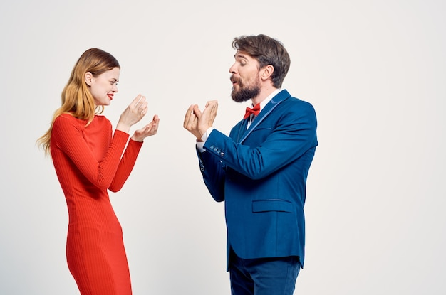 Cheerful men and women are standing next to each other emotions of communication studio