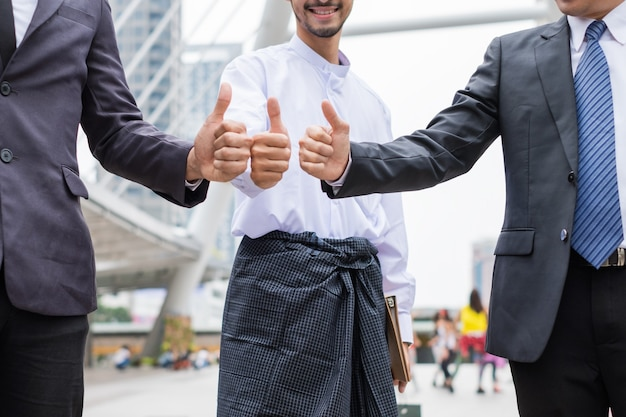 Cheerful multiracial businessman teamwork with giving thumbs up