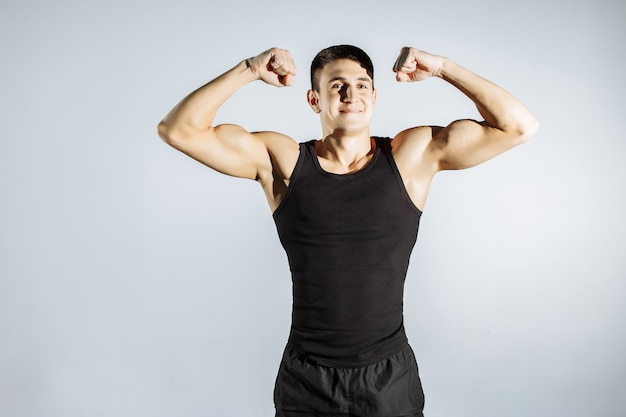 Cheerful muscular guy posing in front