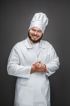 Cheerful overweight chef rubbing hands