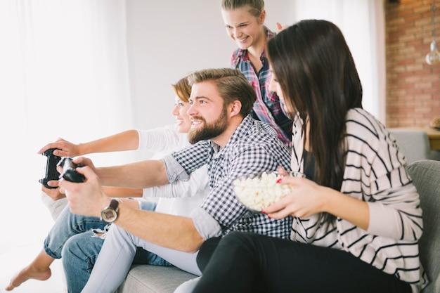 Cheerful people playing game on party