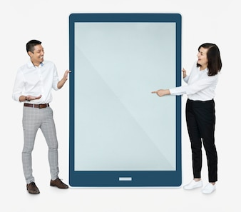 Cheerful people pointing at a tablet screen