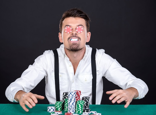 Cheerful poker player with chips