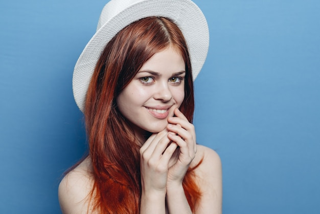 Cheerful pretty woman in a hat attractive look close-up. high quality photo