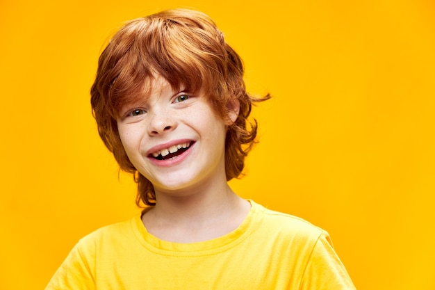 Cheerful redhead child smiles isolated