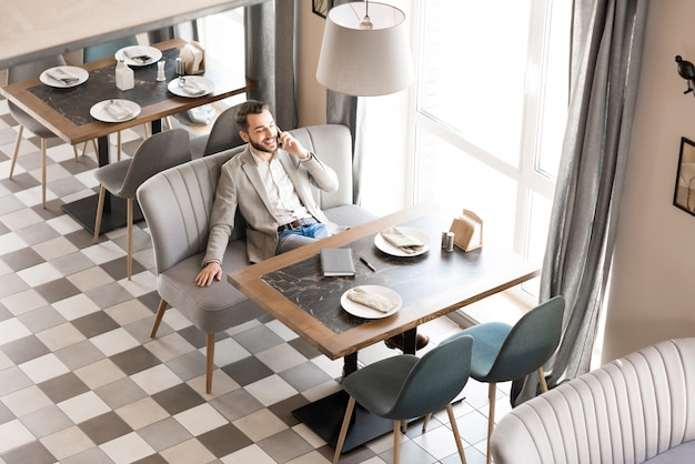 Cheerful relaxed man at business lunch