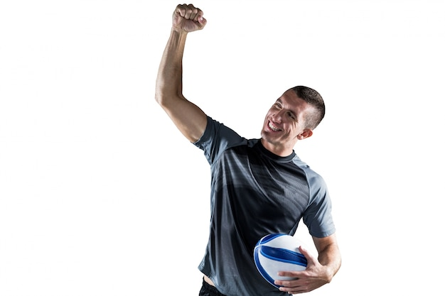 Cheerful rugby player punching the air