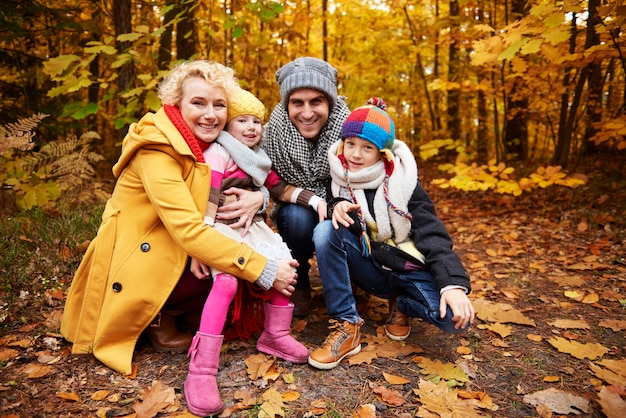 Cheerful scene of family in forest