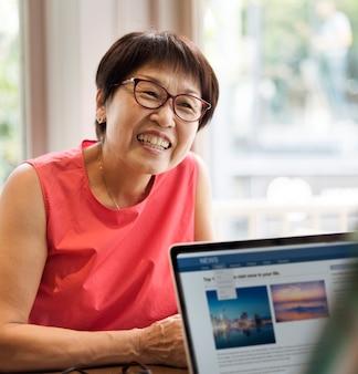 Cheerful senior asian woman