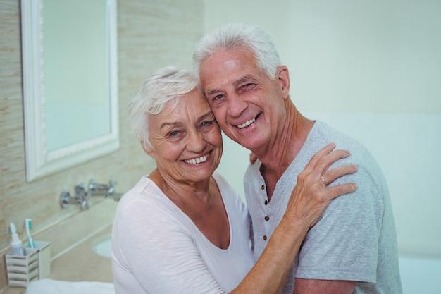 Cheerful senior couple in bathroom