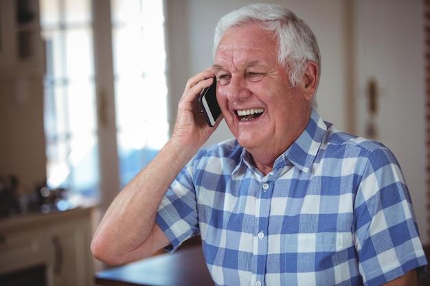 Cheerful senior man talking on mobile phone