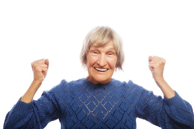 Cheerful senior woman gesturing victory