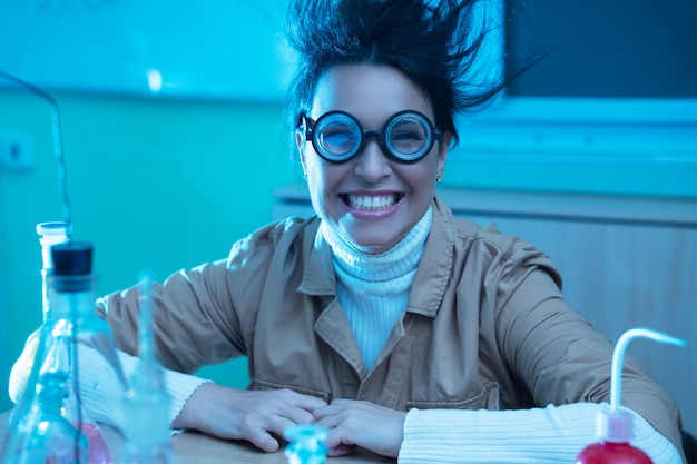 Cheerful and smiling chemistry teacher in funny image