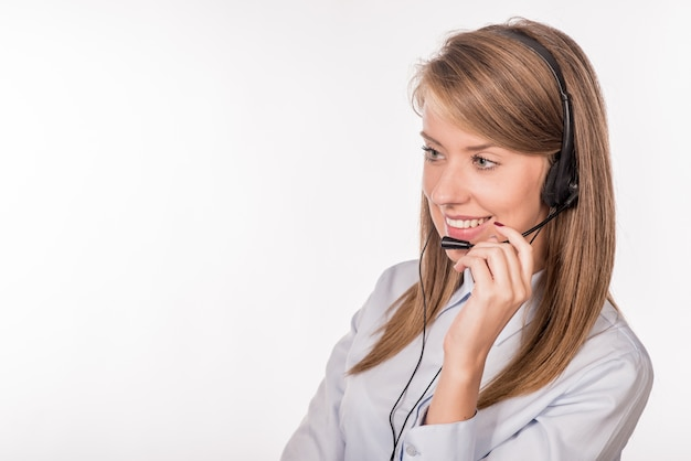 Cheerful smiling support phone female operator in headset at off