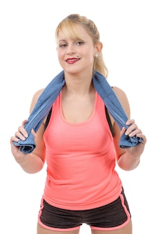 Cheerful smiling young woman with towel after gym