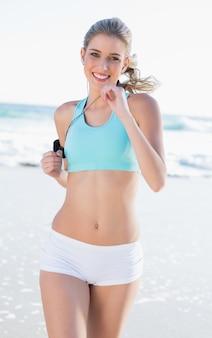 Cheerful sporty blonde in sportswear jogging