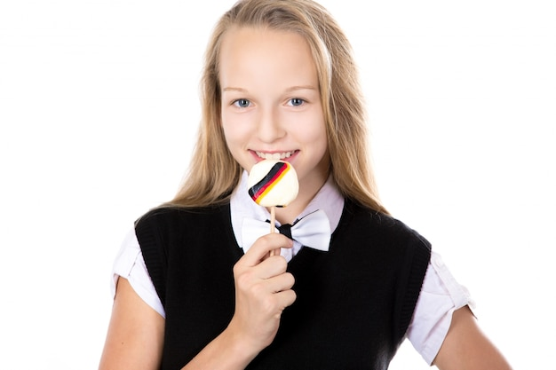 Cheerful student biting a lollipop