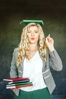 Cheerful student with books. concept of education and education.