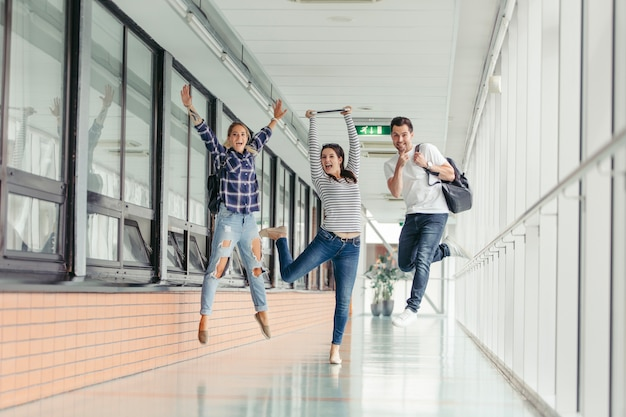 Cheerful students jumping