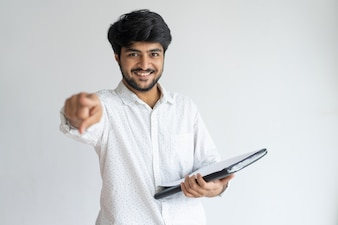 Cheerful successful Indian male entrepreneur pointing at you.