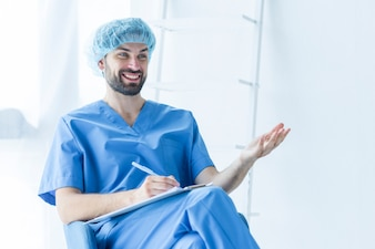 Cheerful surgeon with clipboard
