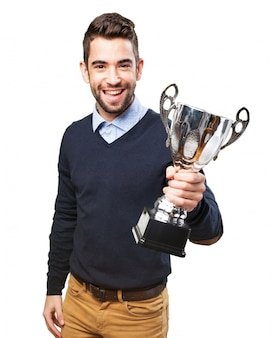Cheerful teenager with his trophy