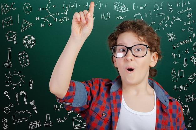 Cheerful thoughtful school boy, back to school