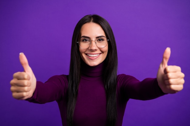 Cheerful toothy beaming entrepreneur showing you double thumb up with positive emotions on face isolated vivid color wall