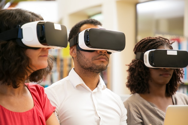 Cheerful users wearing vr glasses