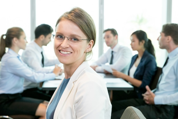 Cheerful woman being part of business community