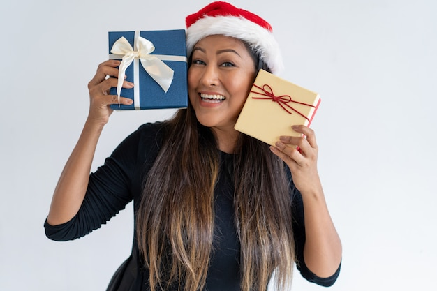 Cheerful woman celebrating christmas