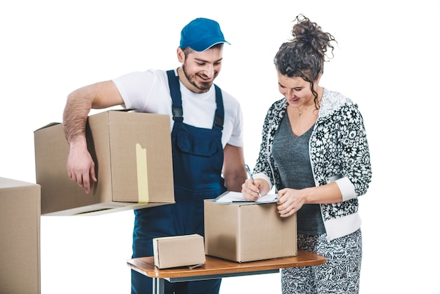 Cheerful woman and courier with parcels