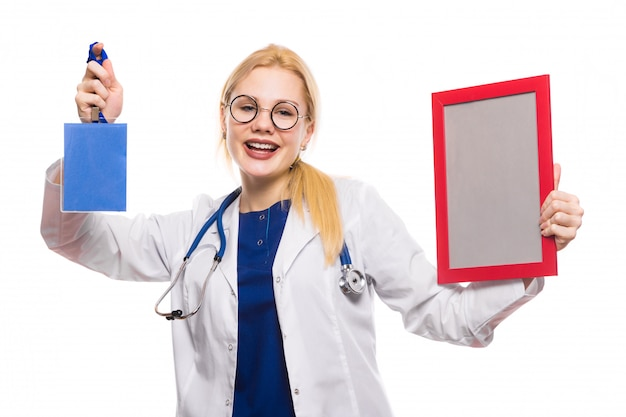 Cheerful woman doctor in white coat with award