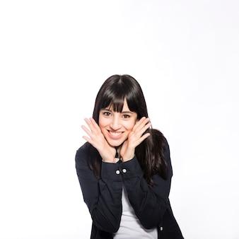 Cheerful woman gesturing and looking at camera