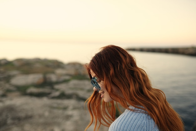 Cheerful woman in glasses outdoors travel enjoyment vacation