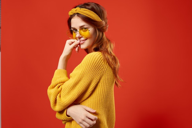 Cheerful woman hippie yellow sweater glasses emotions red.