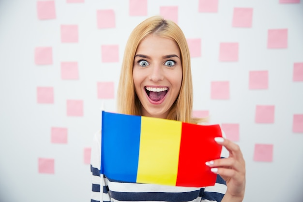 Cheerful woman holding romanian flag
